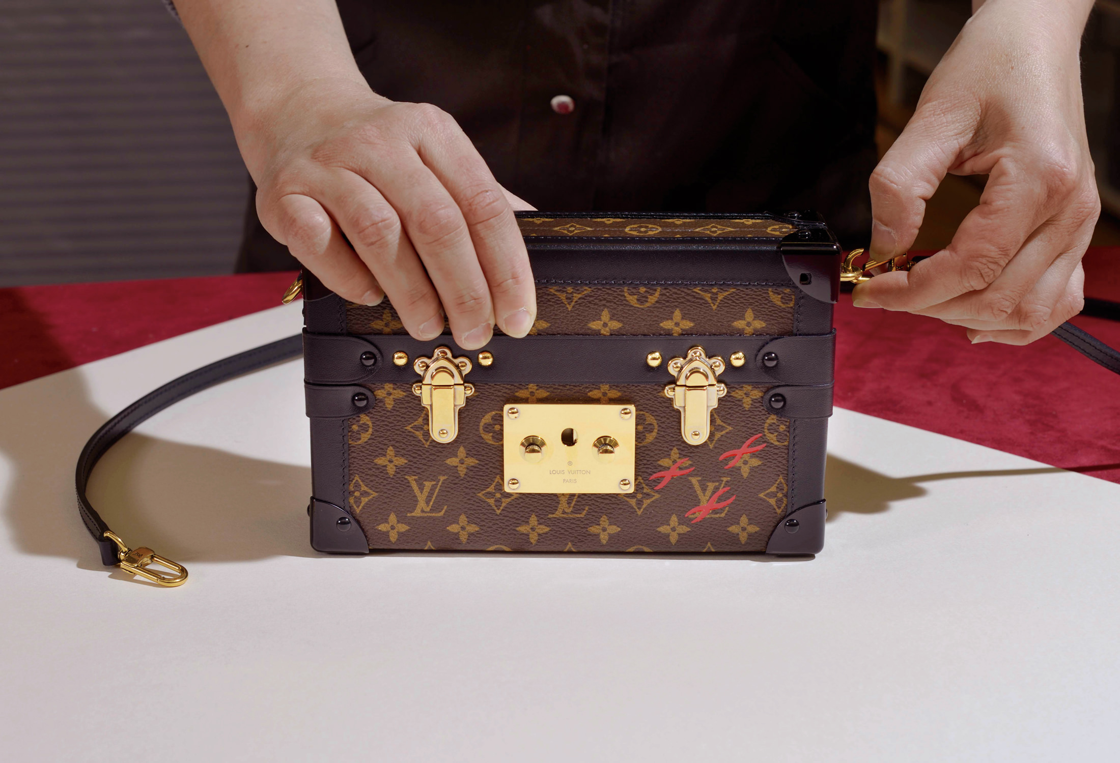 11d793d2b9ee The Petite Malle clutch is a miniature replica of the maison s early trunks.  Photo©Louis Vuitton Malletier.