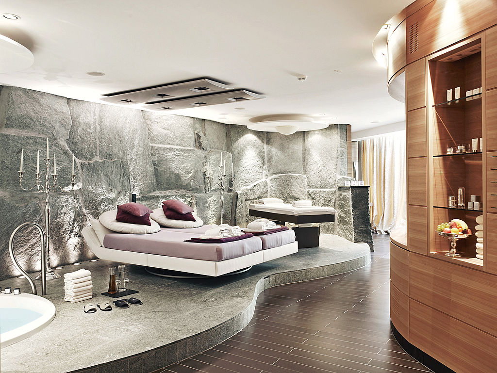 Massage chairs in stone room.