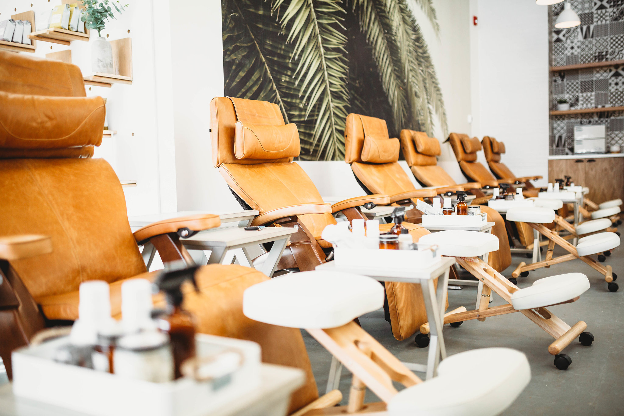 A gender neutral nail bar with meditation during treatments: Drift Luxury Nail Bar.