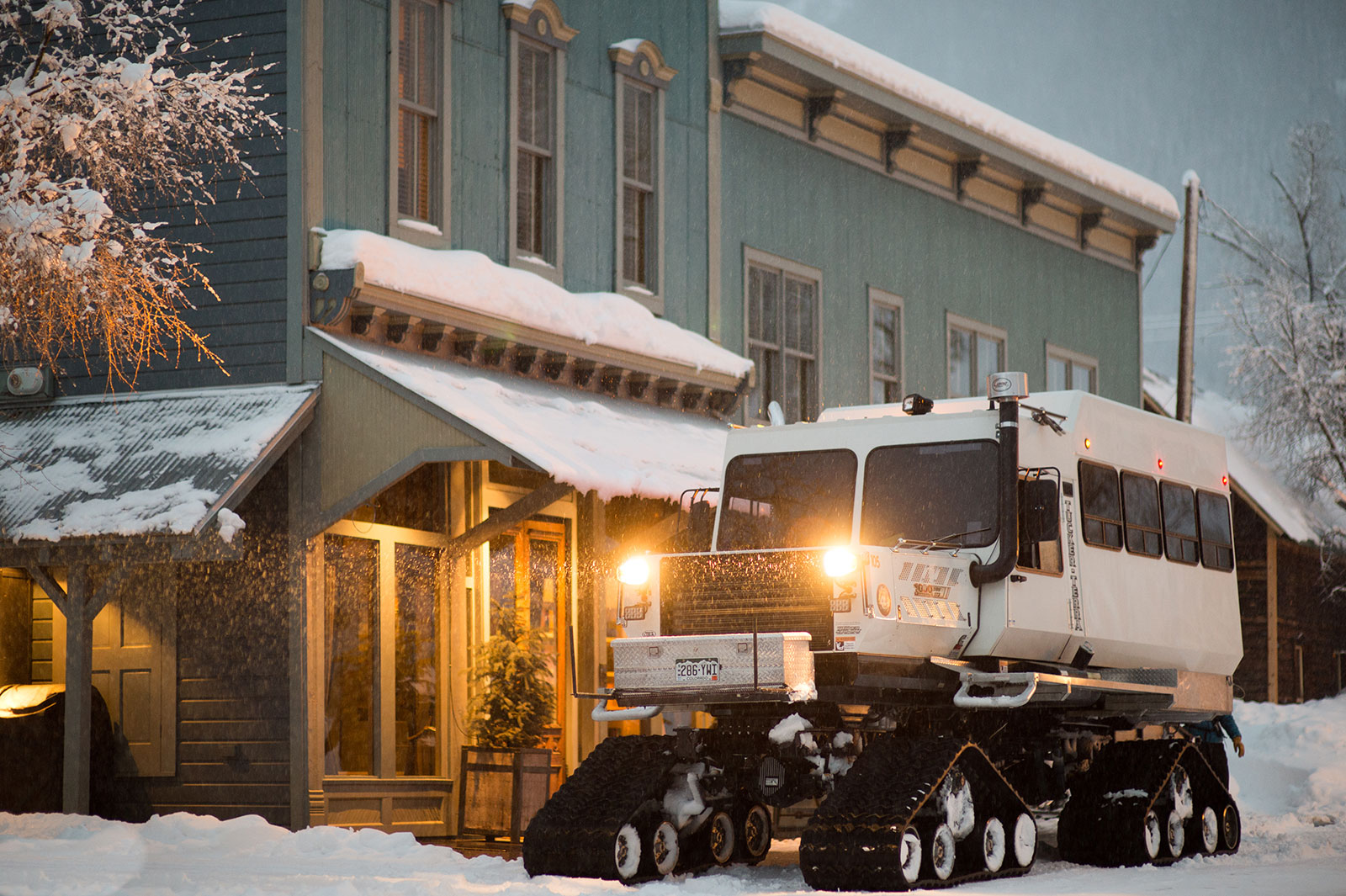 a private snowcat in front of Scarp Ridge Lodge, Crested Butte
