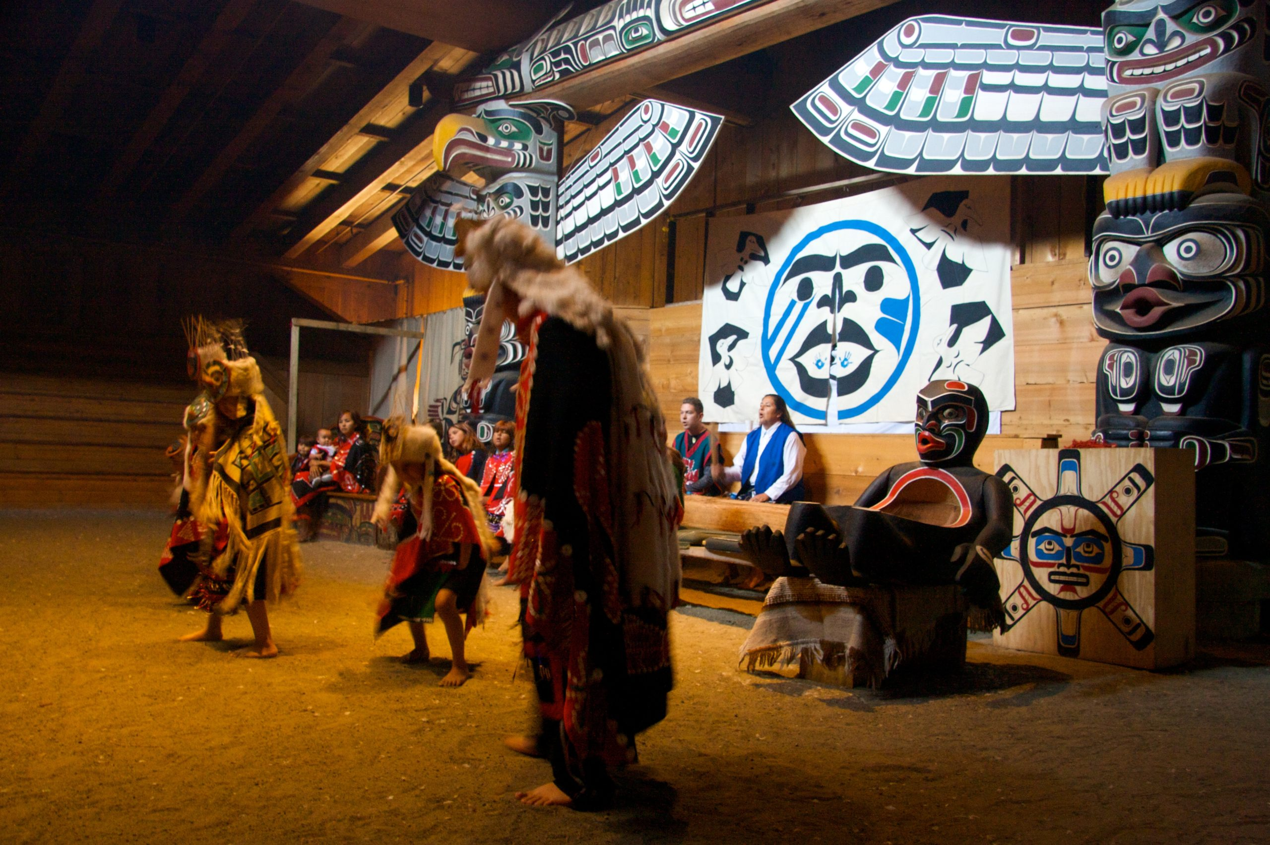 T'sasa-a Dancers inside Big House at Alert Bay, B.C.