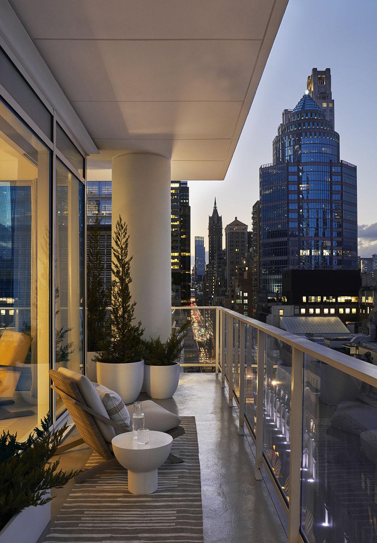 white collumn skyscraper new york patio