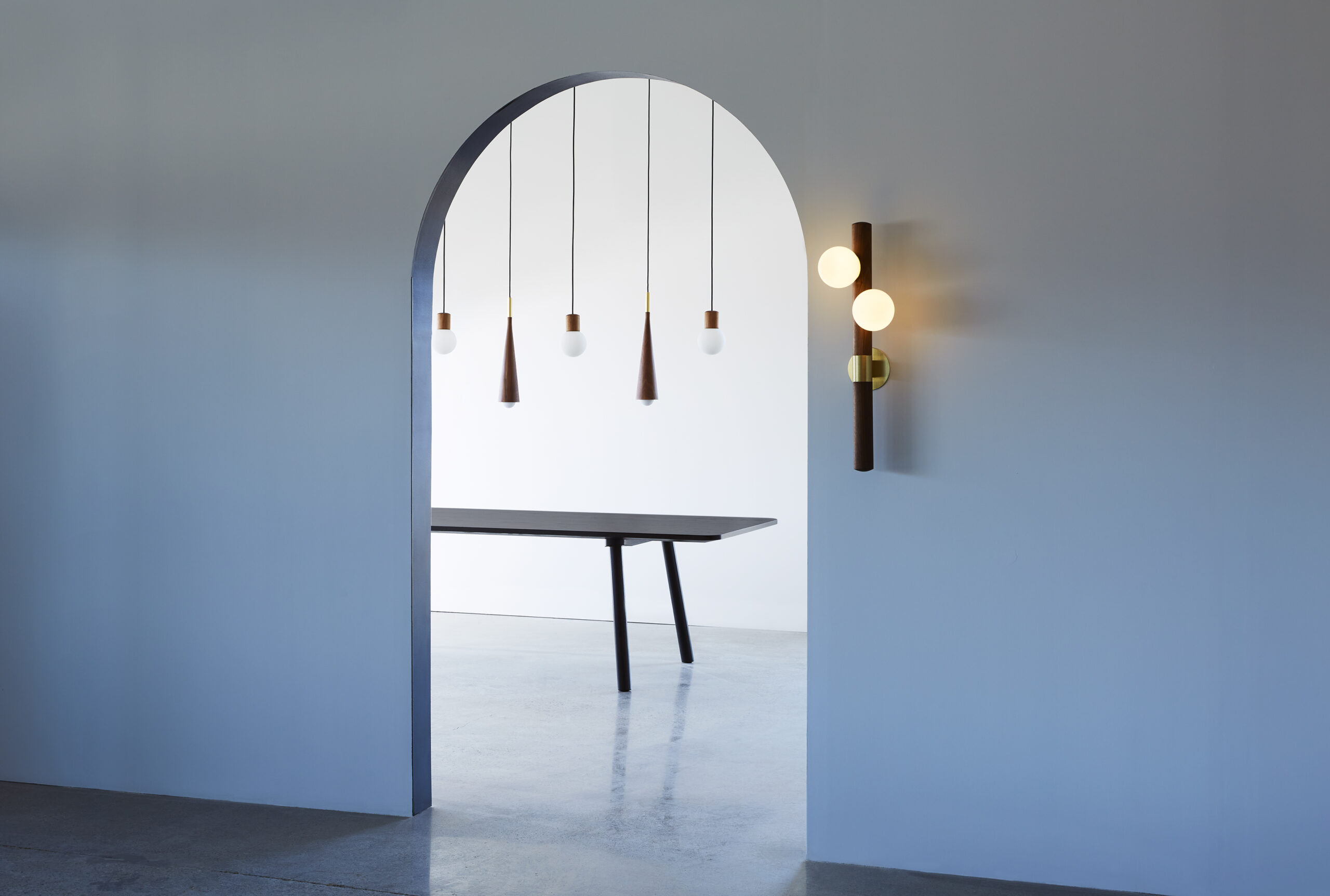 Lighting design. Stem and Catkin pendants in the background; Willow Sconce in the foreground. Moody arch.