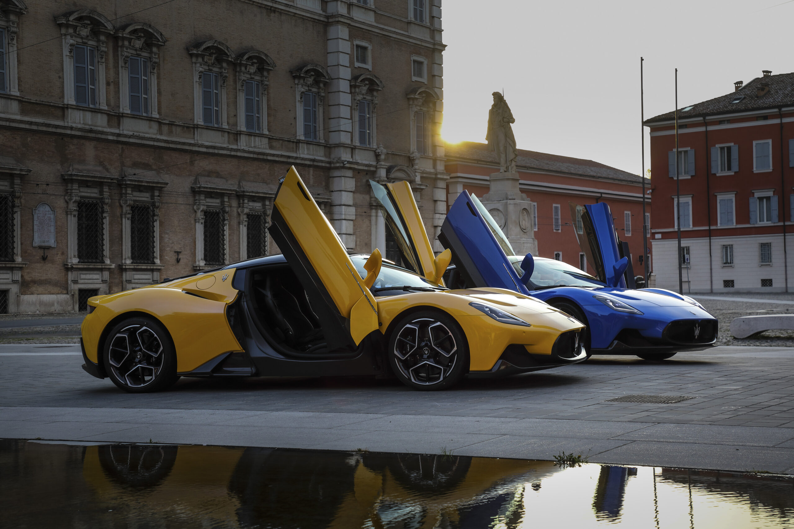 The Maserati MC20 yellow and blue in piazza.